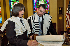 A Bar Mitzvah boy reading from an Ashkenazi-style Torah Scroll.