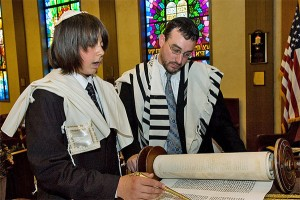 A Bar Mitzvah boy reading from the Torah