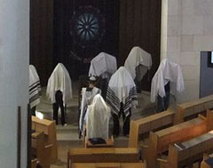 Kohanim performing Birkat Kohanim in a synagogue.