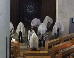 Kohanim performing Birkat Kohanim in a synagogue.