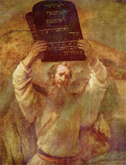 Moses holding the 10 Commandments aloft, as painted by Rembrandt
