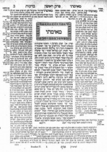 A page from the Taljud. The cetral block of writing (underneath the boxed word in large lettering) is an extract from the Mishna, and the blocks of text surrounding it are commentaries on and explanations of the Mishna.