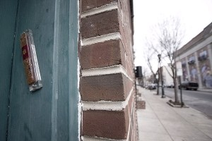 A typical mezuzah on the doorpost of a home. The parchment is concealed within the external case. Photo courtesy of www.retardstrength.net and Wikimedia Commons.