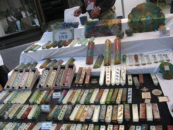 This Israeli street stall has mezuzah cases in a variety of designs, sizes and colours available for sale. The scroll to go inside the case is purchased separately.