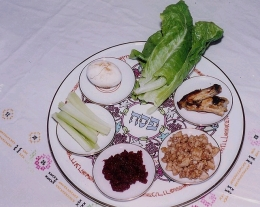 A seder plate with traditional ritual foods.