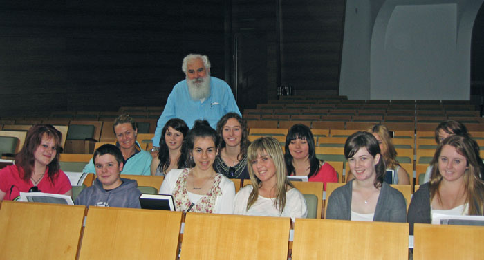 A group of students with the presenter who has addressed them