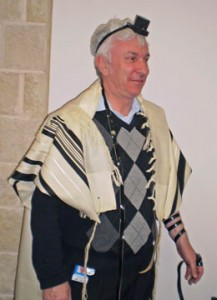 A man wearing a tallit and tefillin