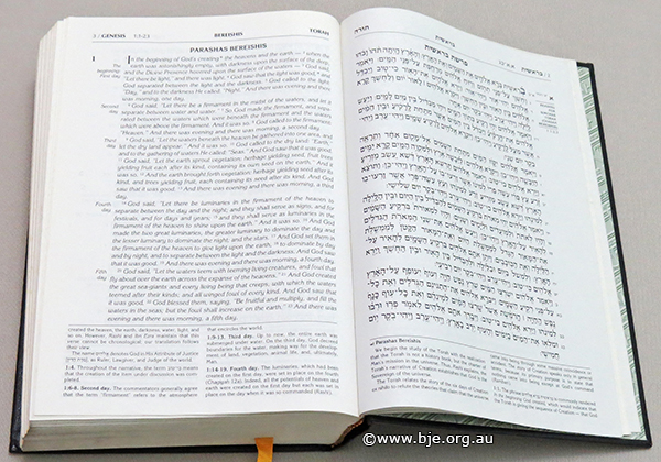 The first page of the Book of Genesis in a contemporary edition of the Tanach which has English translation placed on the page opposite the Hebrew. The writing at the bottom of the page is commentary (explanation of the text above). Note that although English reads from left to right, Hebrew reads from right to left - hence the Hebrew text starts on the outside edge of the page. This also explains why, to eyes used to English language books, this page appears to be near the back of the book - in fact, it is near the front as the Tanach is a Hebrew language book which reads from right to left.