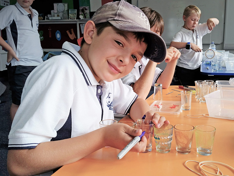 A BJE Extensiion student enjoying an in-class activity