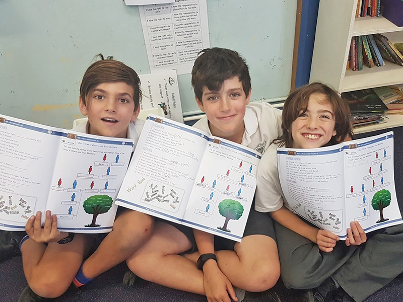 SRE students with their workbooks