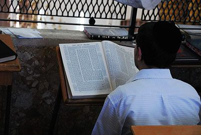 A man studying a page of Talmud